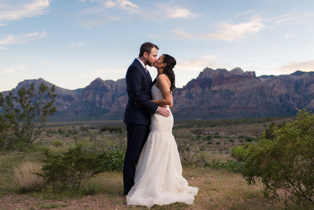 bride and groom kissing at red rock canyon state park las vegas nevada elopement wedding