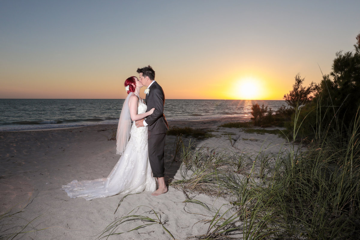 Siesta Key Wedding Photography with bride and groom kissing at sunset on the beach