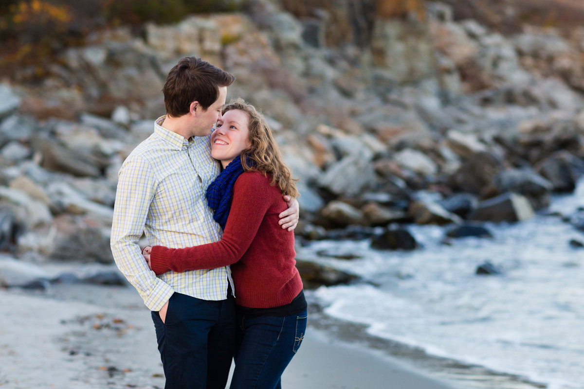 Fort Williams beach during the fall gives the couple a place to walk during their engagement session