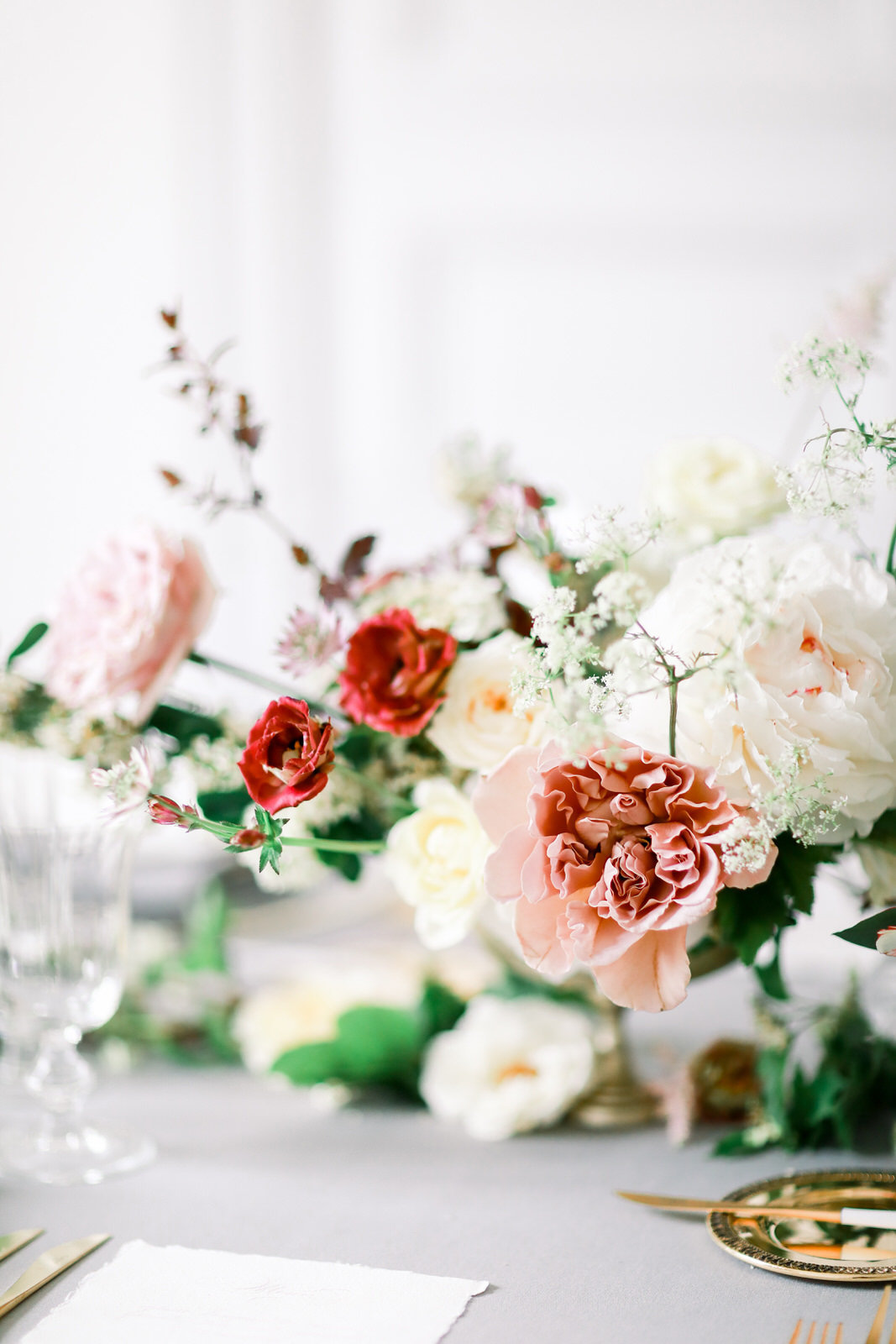 A destination wedding photographer based in North Carolina photographs a classic French wedding table at a Paris wedding.