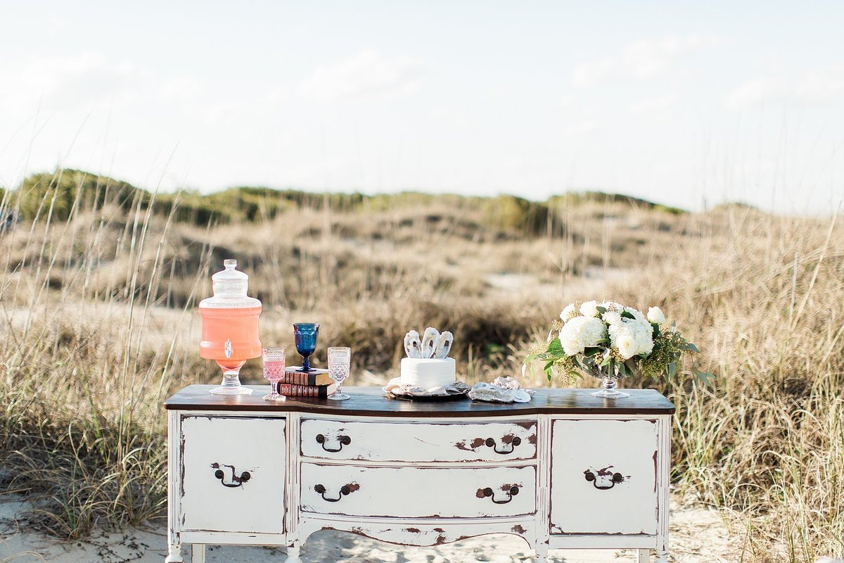 A styled buffet in the sand dunes.