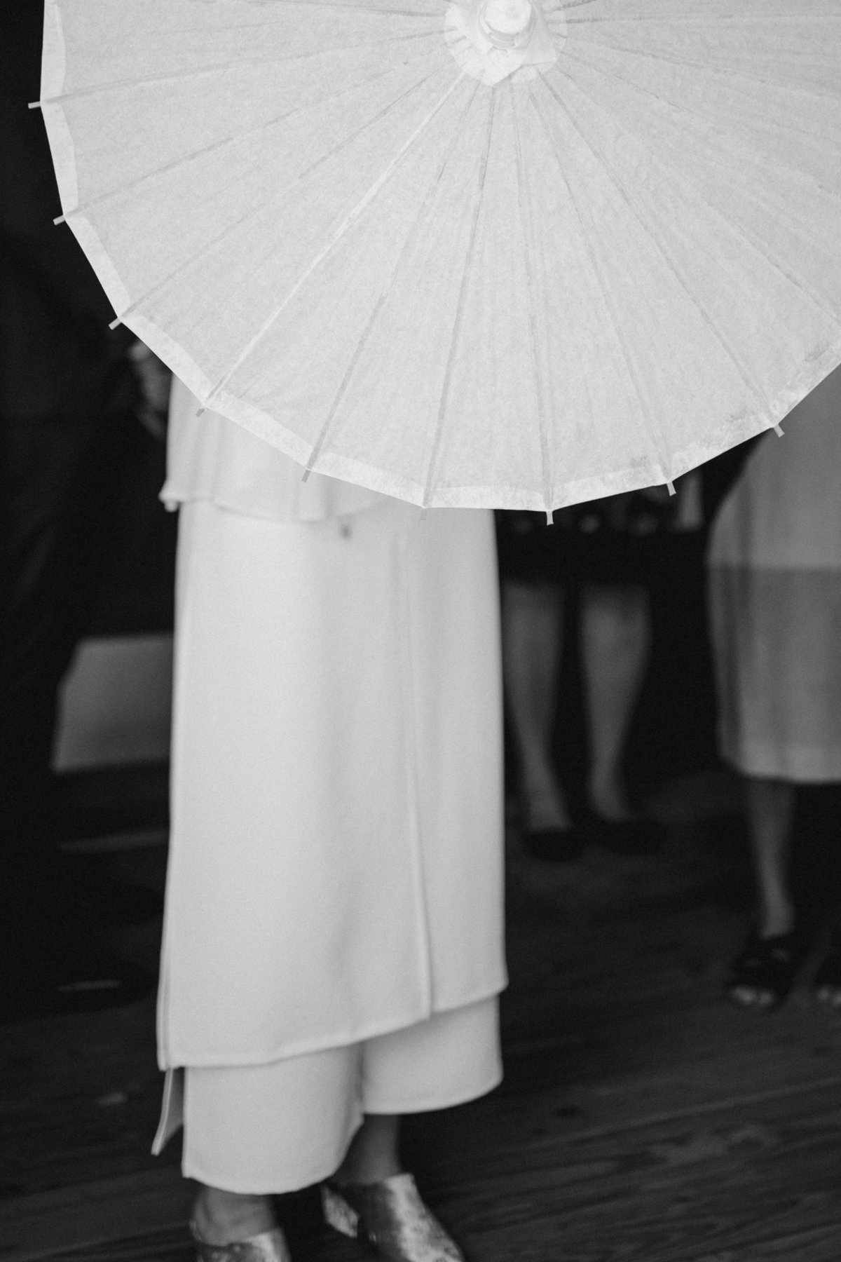 Bridal jumpsuit and parasol