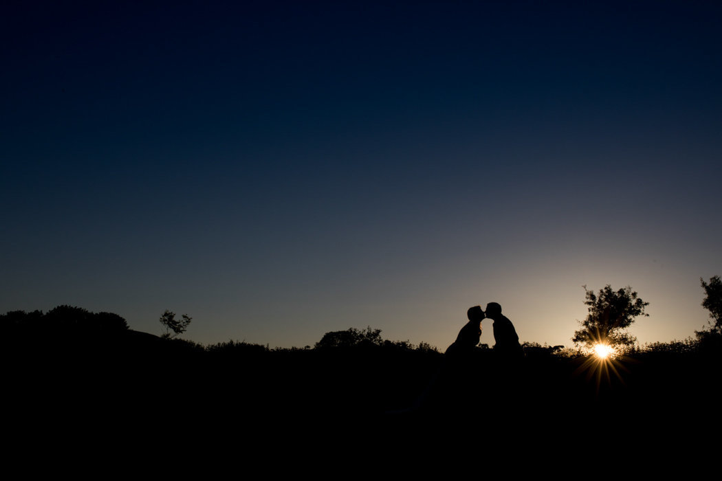 Sunset wedding photo of couple kissing at The Green Weddings in Cornwall