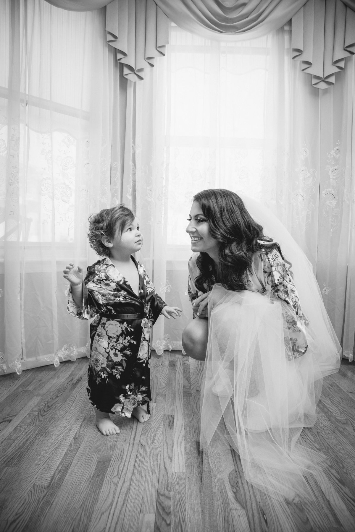 bride getting ready with flower girl before clarks landing yacht club wedding