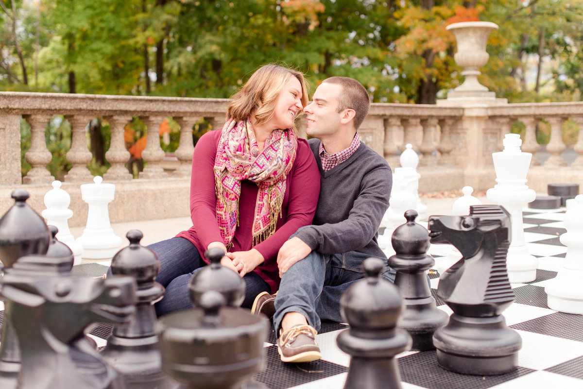 crane estate engagement photos on a life sized chess board.