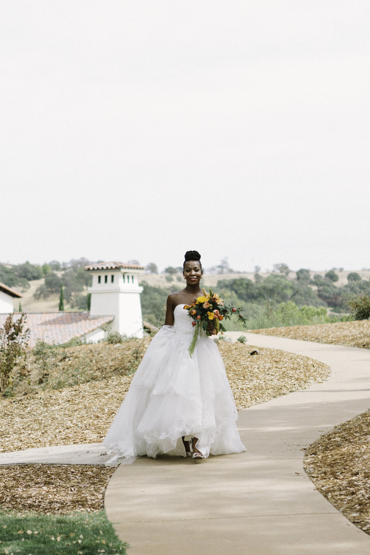 Bride of color strolling through carmel wedding venue