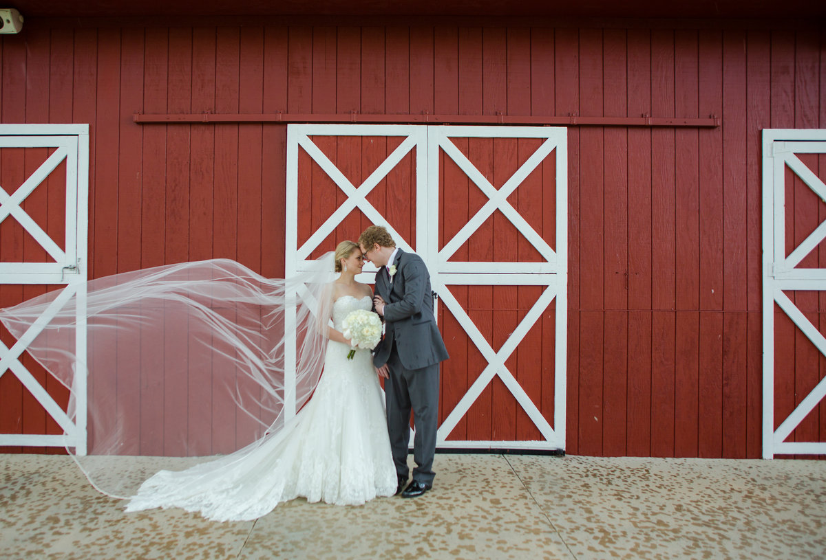 couple red barn at crooked willow