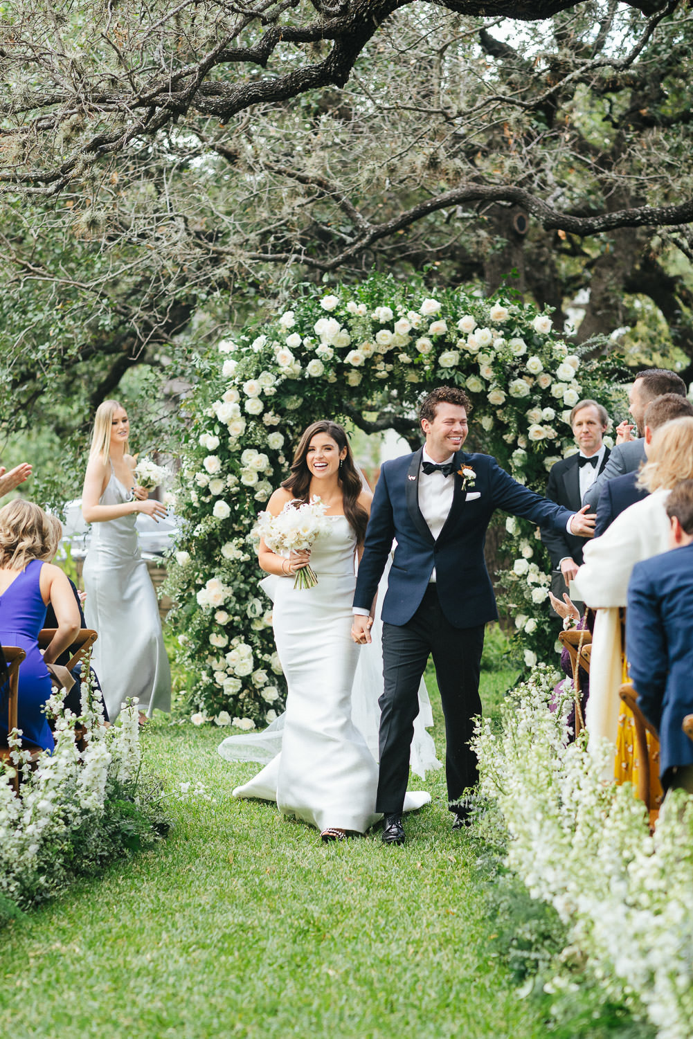 groom and bride ceremony recessional smiling Matties wedding Austin