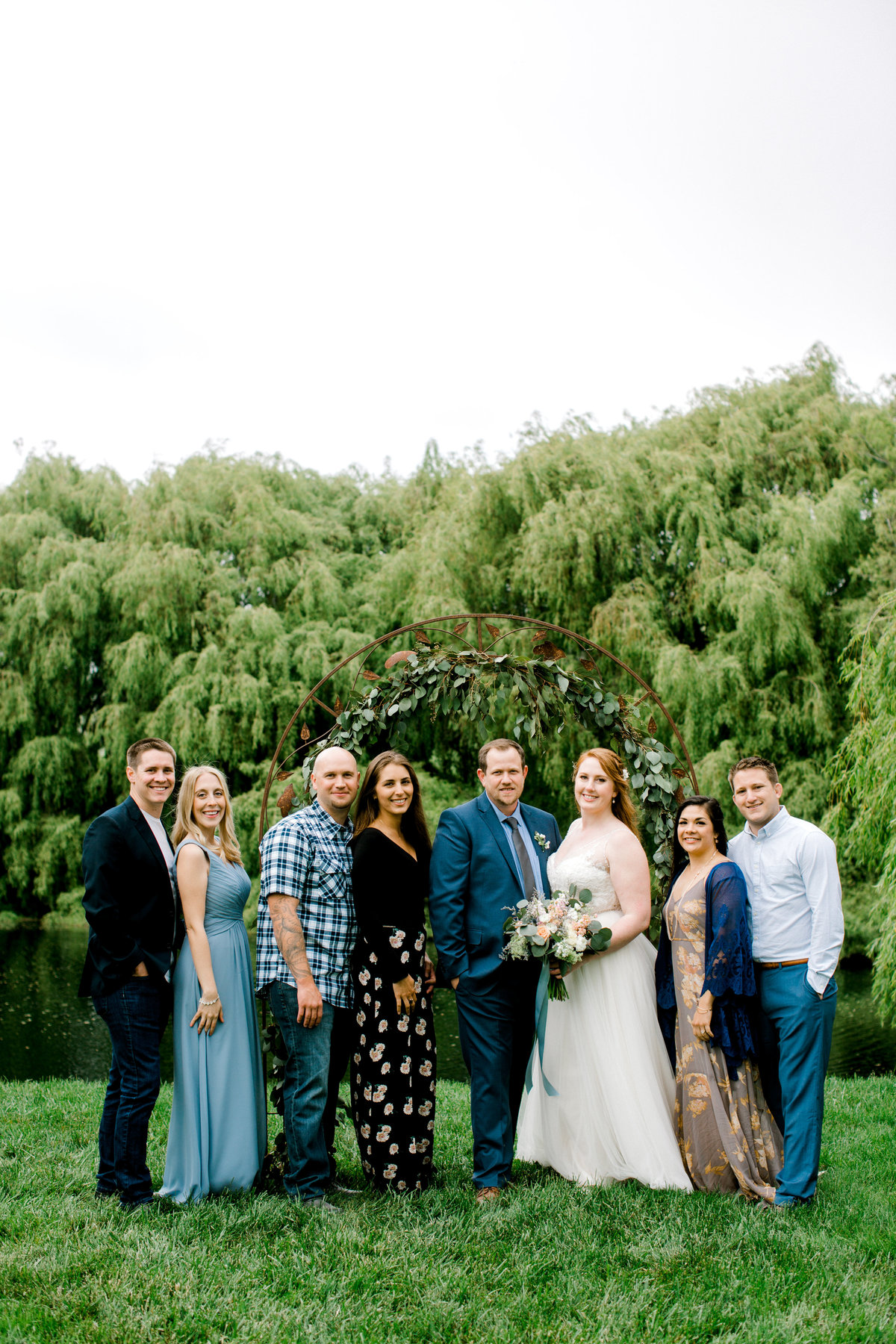 Bride and groom posing with guests during elopment at Olympias Valley Estate in Petaluma California