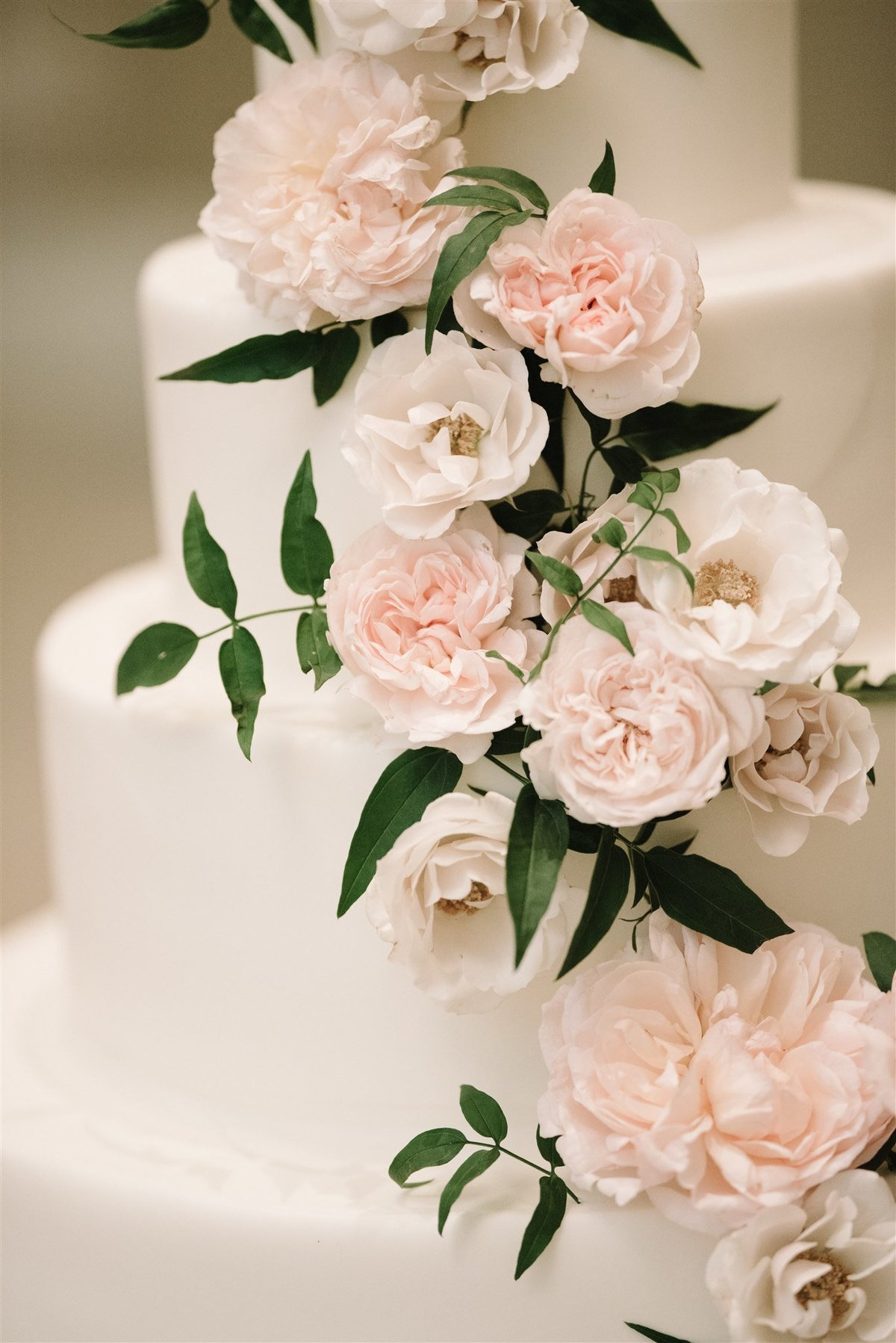Flower covered wedding cake for a Cape Cod Wedding by luxury Cape Cod wedding planner and designer Always Yours Events