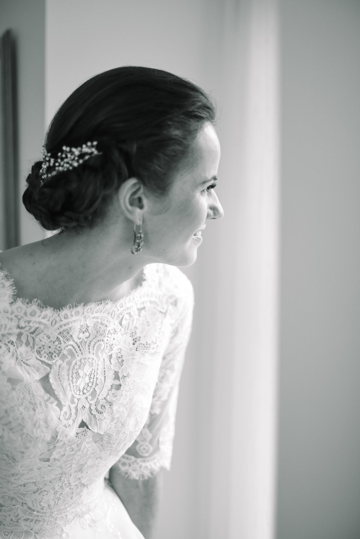 Bride looks out window before getting ready