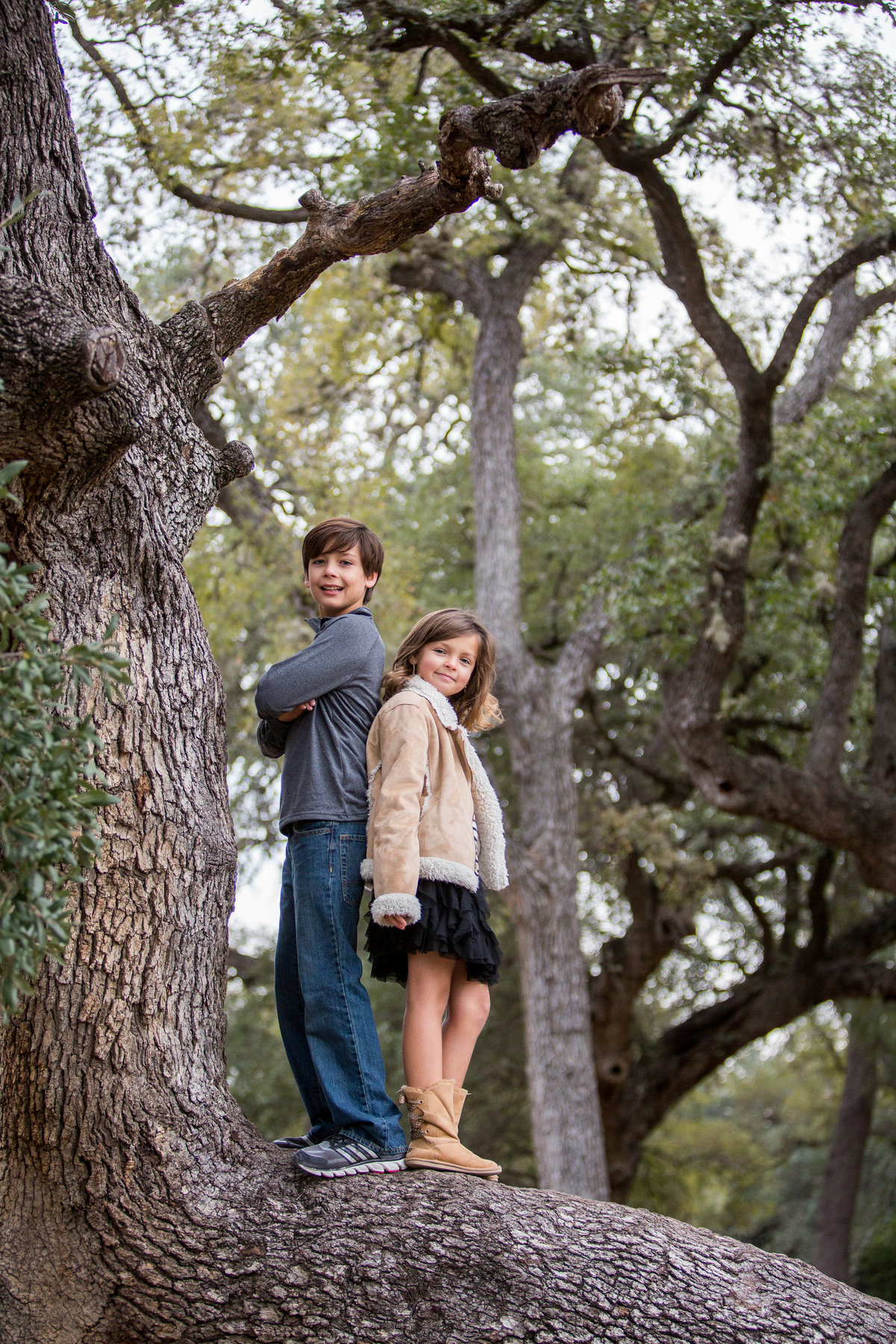 brother & sister standing tree branch for family photography taken by San Antonio Photographer Expose The Heart Photographer