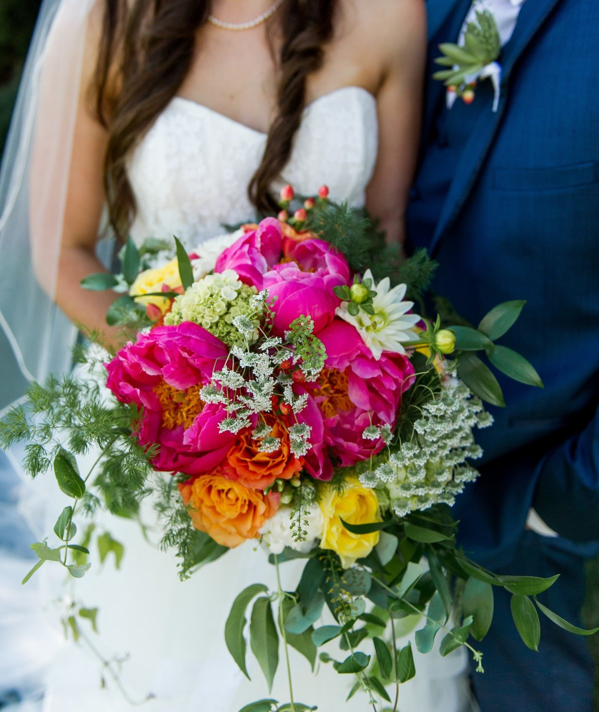 Wedding couple with bridal bouquet
