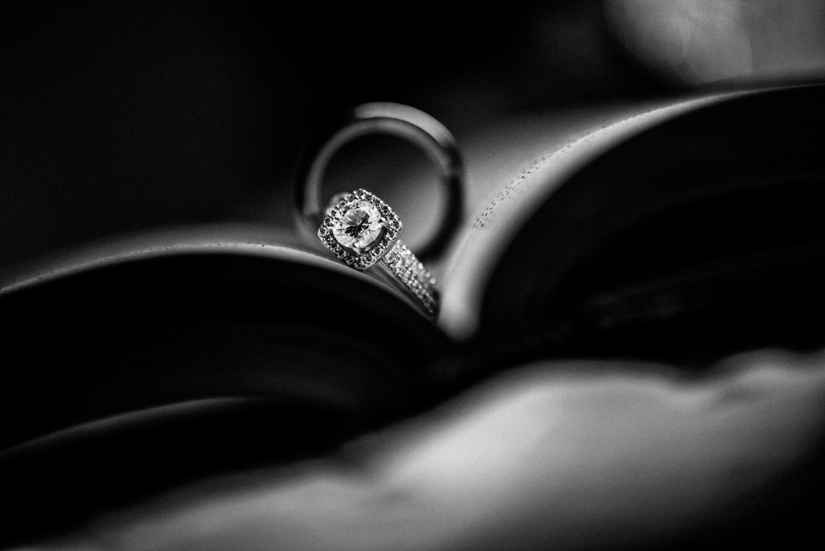 dramtic photo of wedding rings on a book