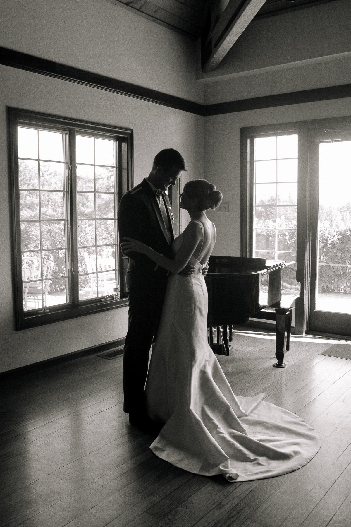 A couple seeing each other for the first time at their wedding at Thomas Fogarty Winery.