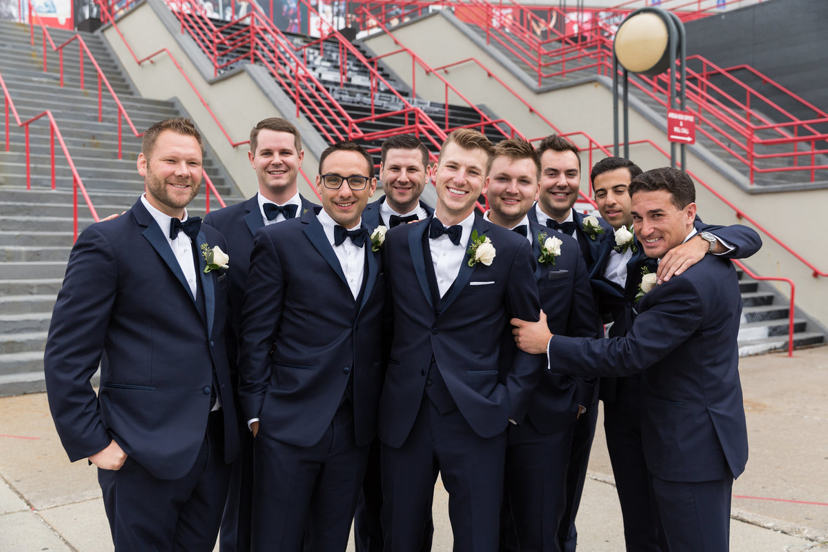Groomsmen in front of the old red wings Joe Louis Arena