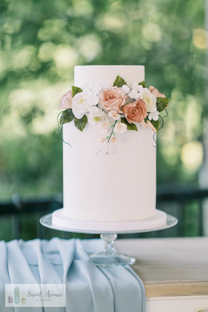 white wedding cake with romantic sugar flowers