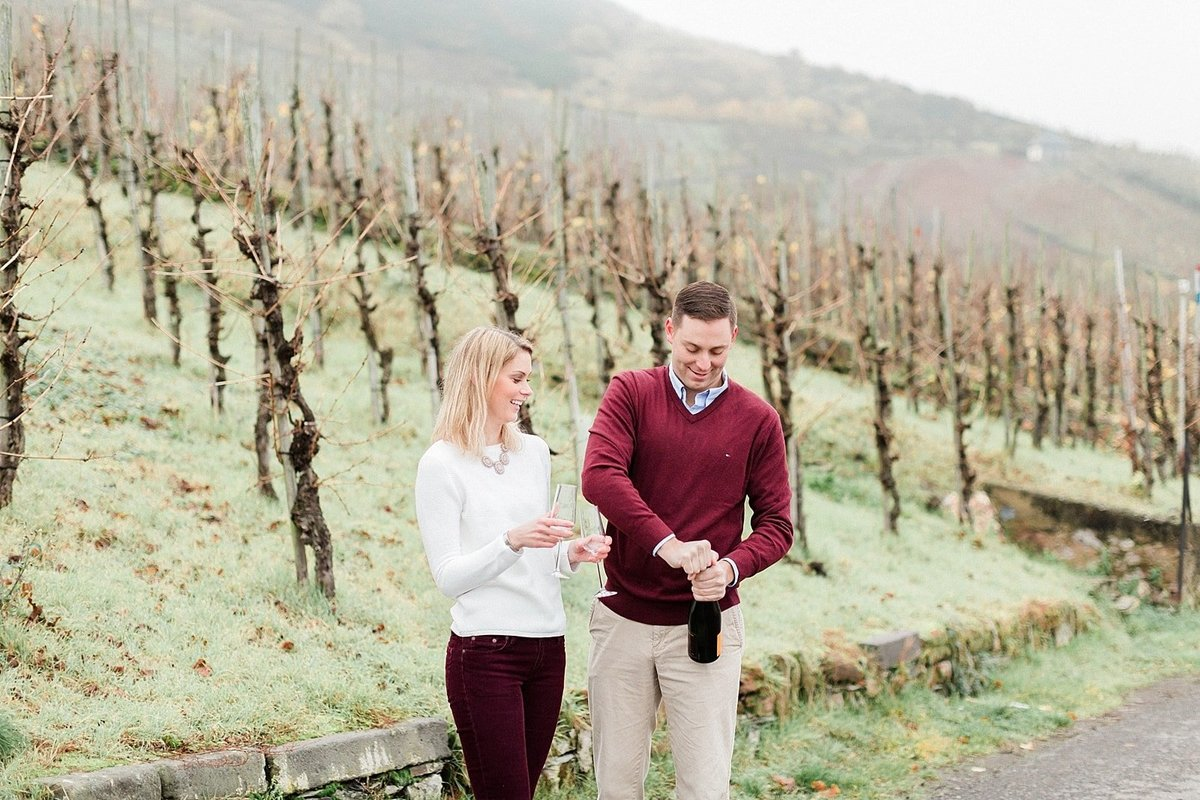 Champagne toast at Germany vineyard engagement session photographed by destination photographer Alicia Yarrish