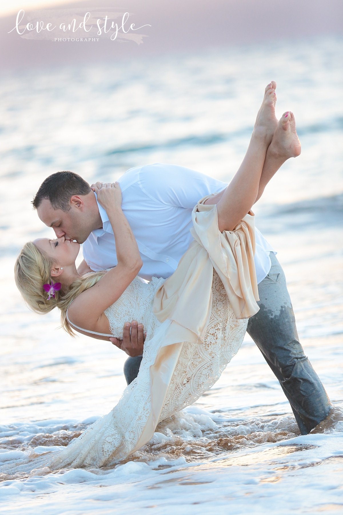 Sarasota-Bradenton Wedding Photography of Groom dipping and kissing bride while standing in the ocean
