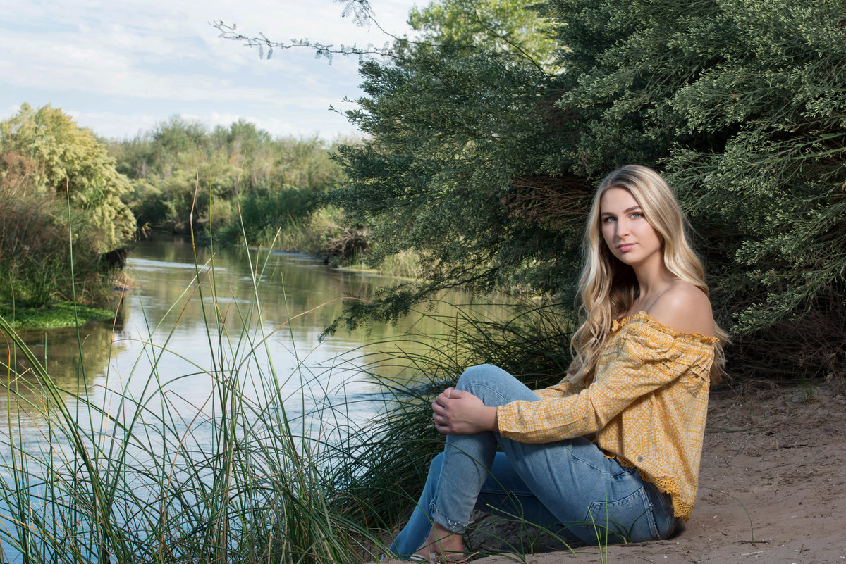 senior portrait by river in Yuma