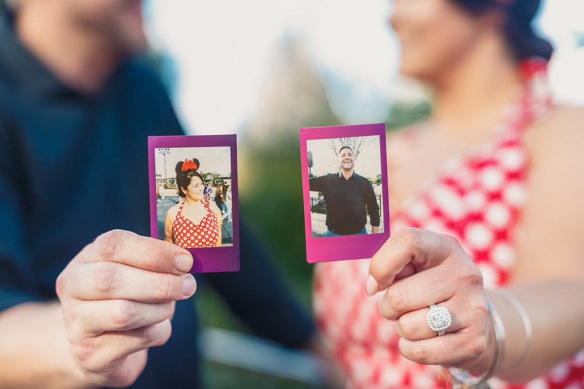 Bride to Be in a Minnie Outfit with Her Fiance as they Hold Polaroids of Each Other at their Disney Bound Engagement Shoot