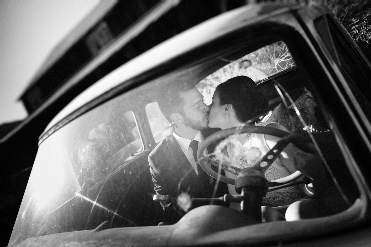 Lake Tahoe engagement pictures couple kisses in vintage car
