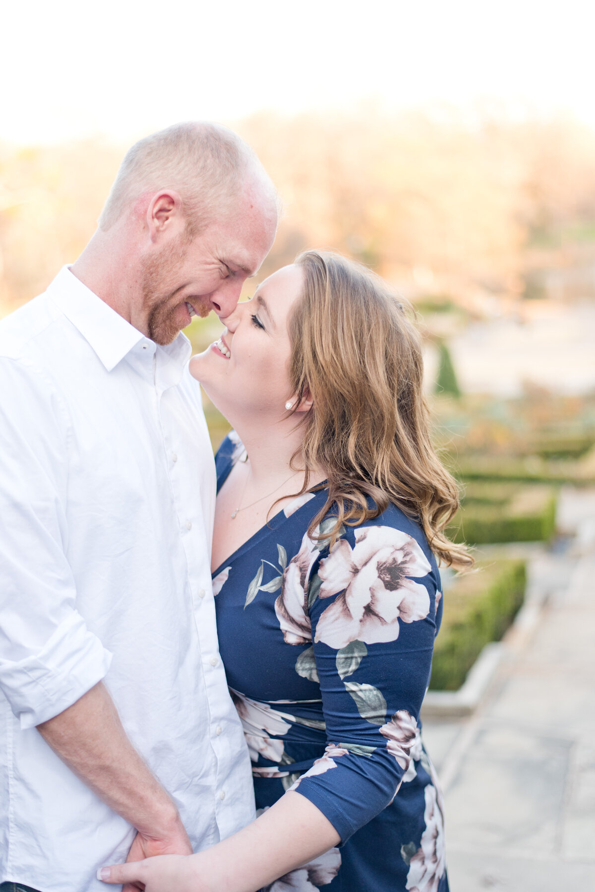 Engagement photo of man and woman touching noses in Fort Worth