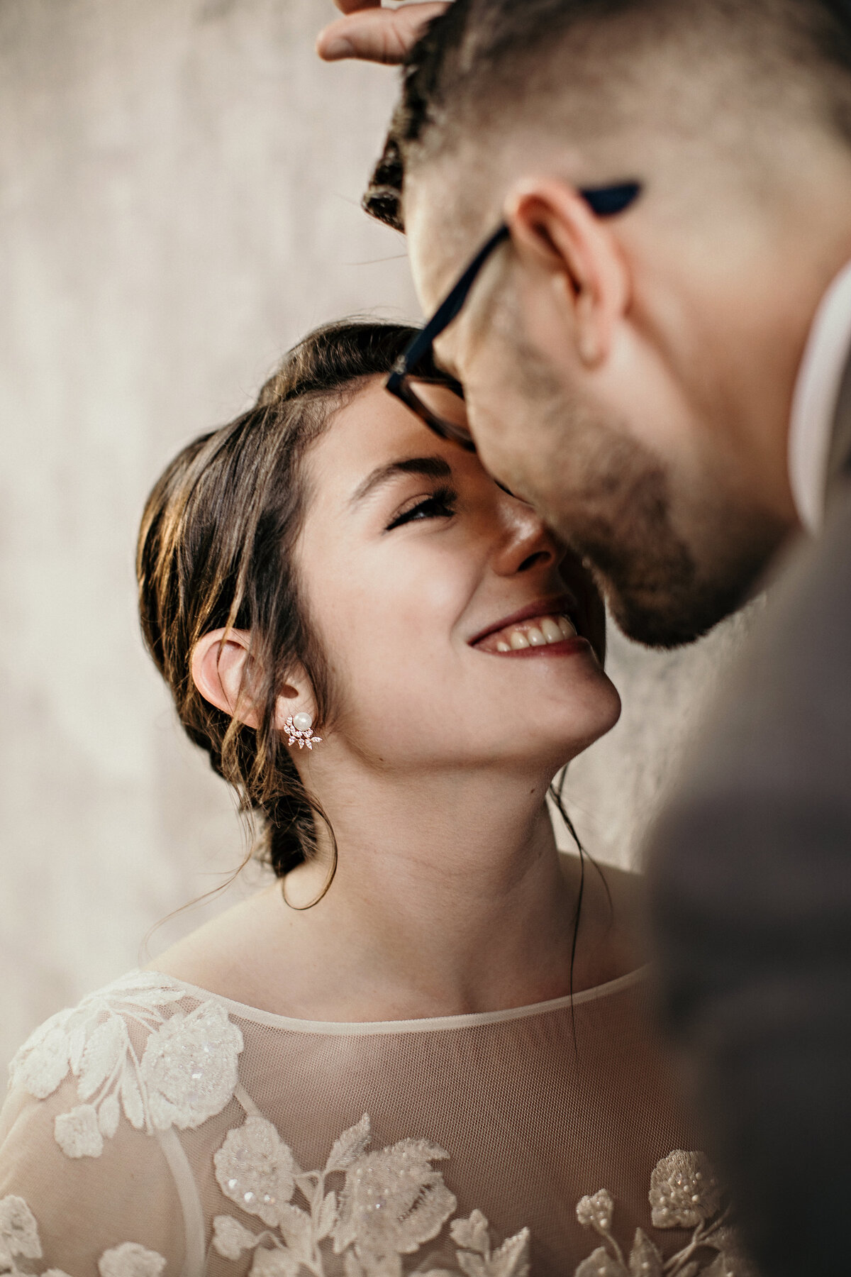 A picture of a closeup view of the bride and groom smiling and tenderly touching noses as they lean in to kiss romantically on their wedding day by Garry & Stacy Photography Co - Clearwater FL wedding photographer