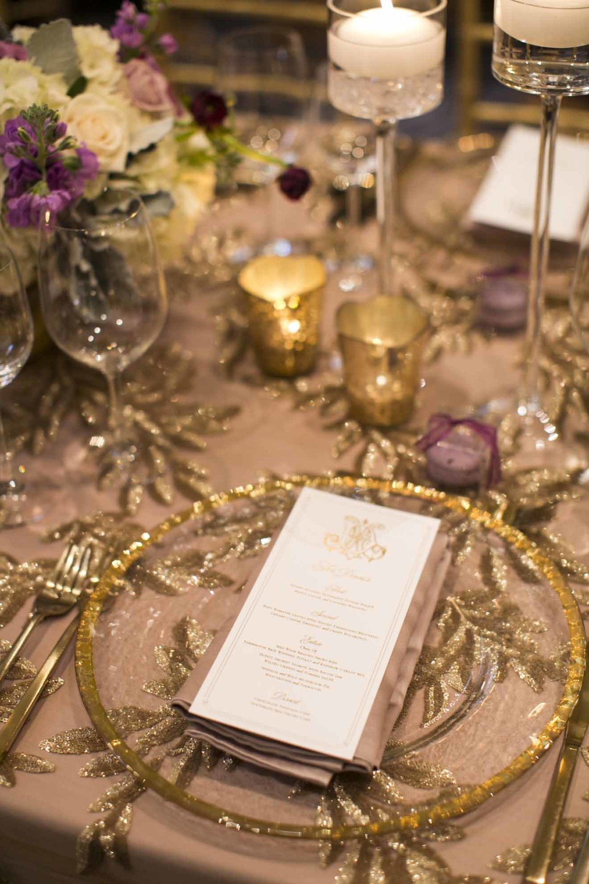 Gold place settings paired beautifully with Purple, and grey floral at this Seattle wedding reception.