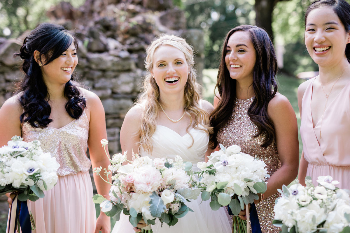 Brides laughing, wearing shades of blush in different fabrics