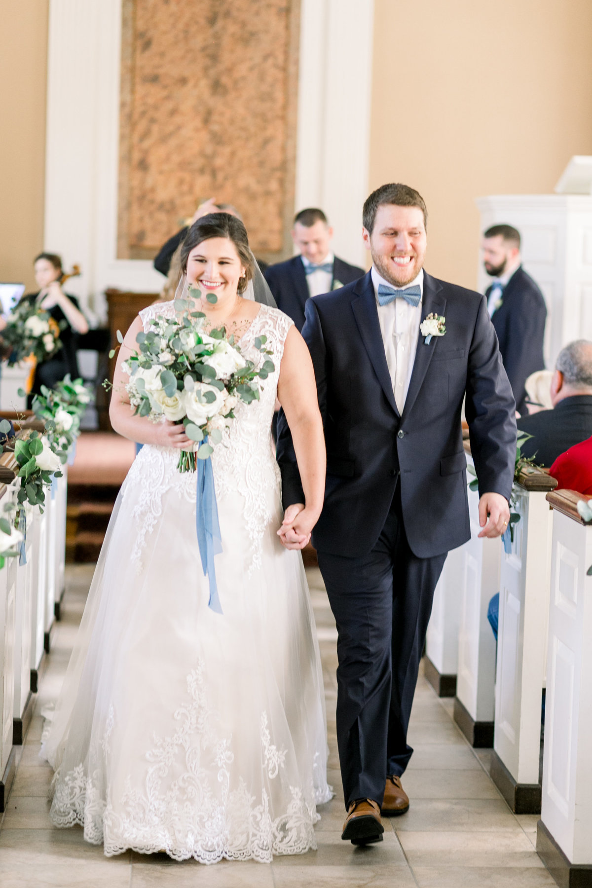 Bride and groom walking down the aisle after there ceremony in Oxford, Ohio