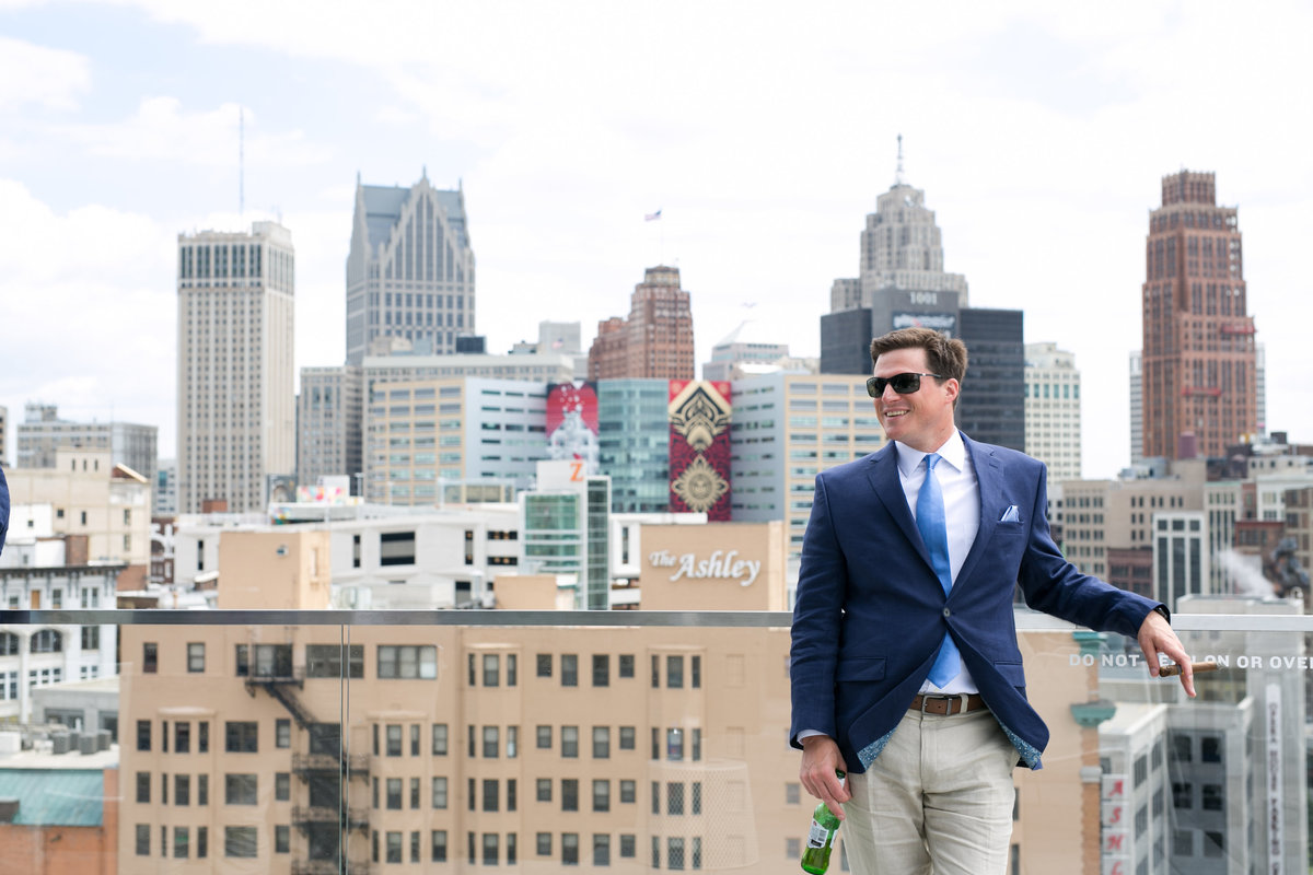 Groom wedding photo on the rooftop of the Detroit Athletic Club, Detroit, Michigan, Detroit skyline, photographer Charlene Gurney