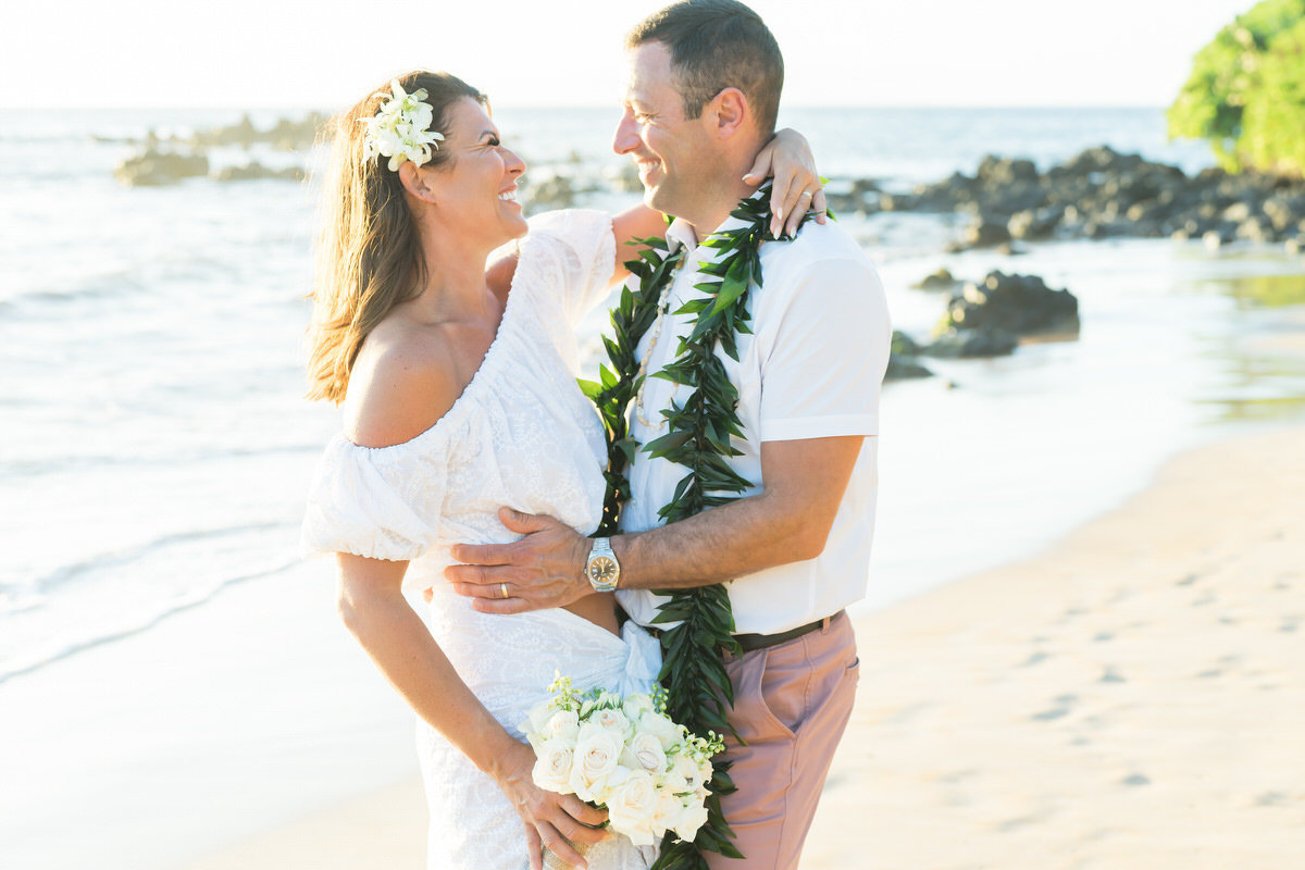 Maui vow renewal embrace