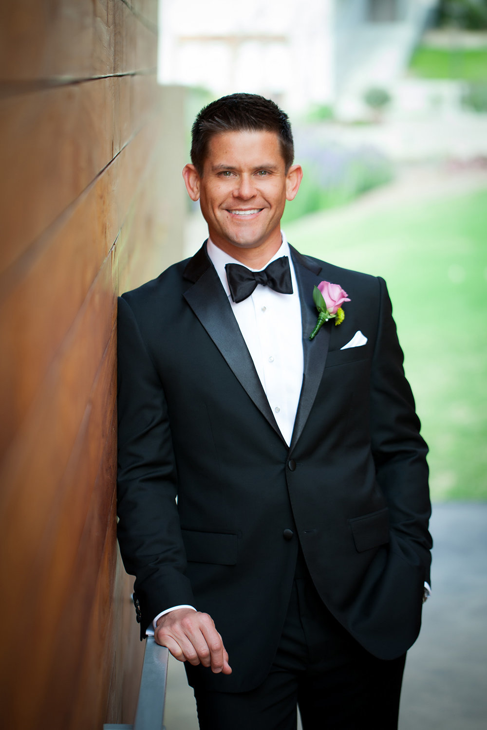 wedding photos groom smiling with nice tux