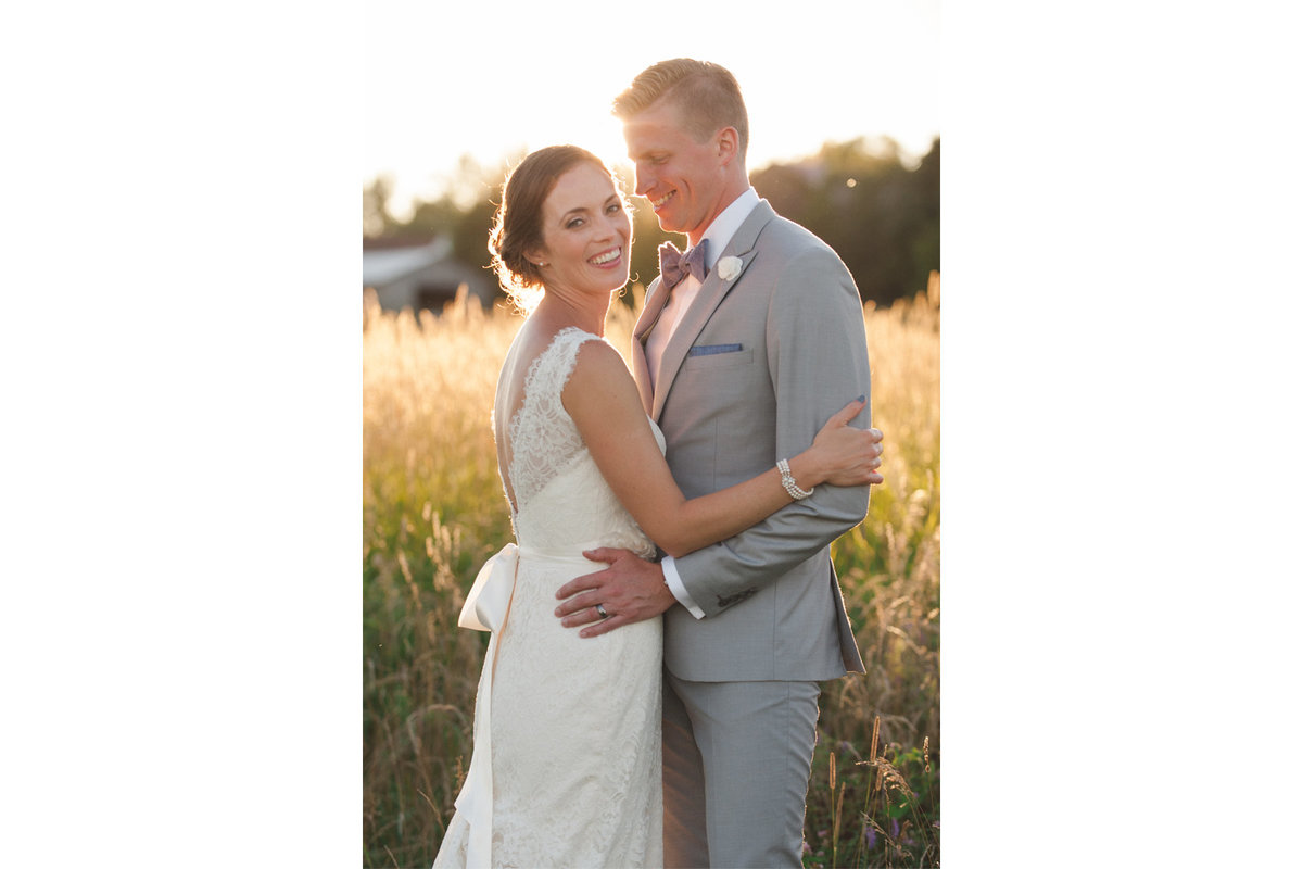Bride and groom at sunset in the fields of Strathmere