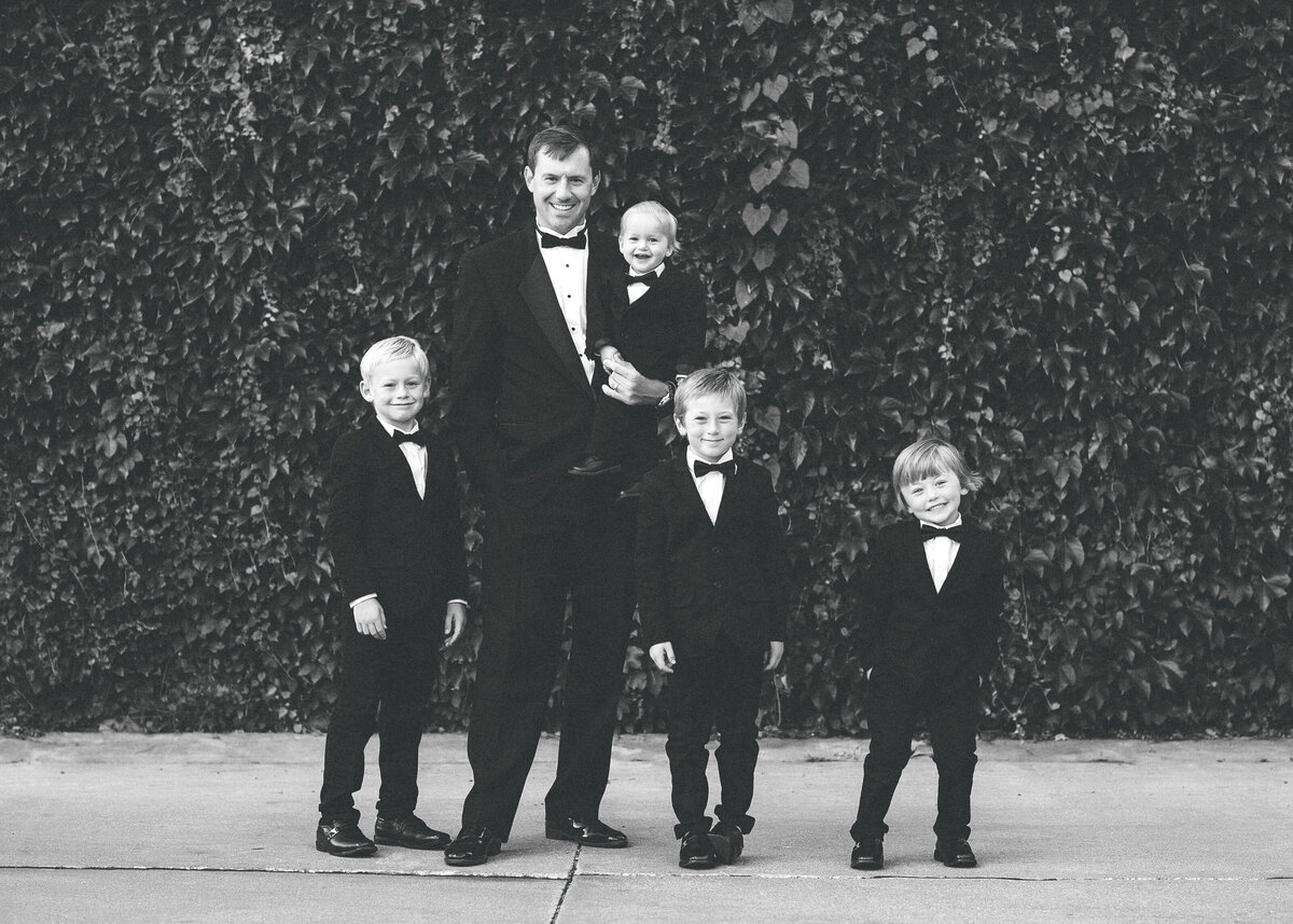 Des-Moines-Iowa-Family-Photographer-Theresa-Schumacher-Formal-Tuxedos-Mickelson-Ivy-Wall-BW