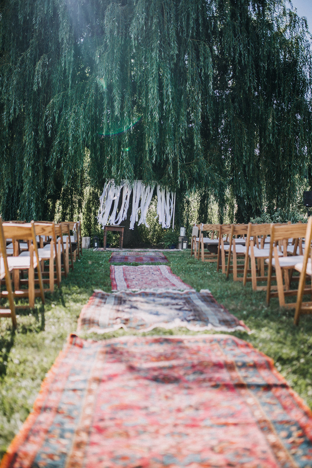 Monica_Relyea_Events_Dawn_Honsky_Photography_Nostrano_vineyard_ceremony_rug_aisle_boho_bride_and_groom_Meg_and_TJ