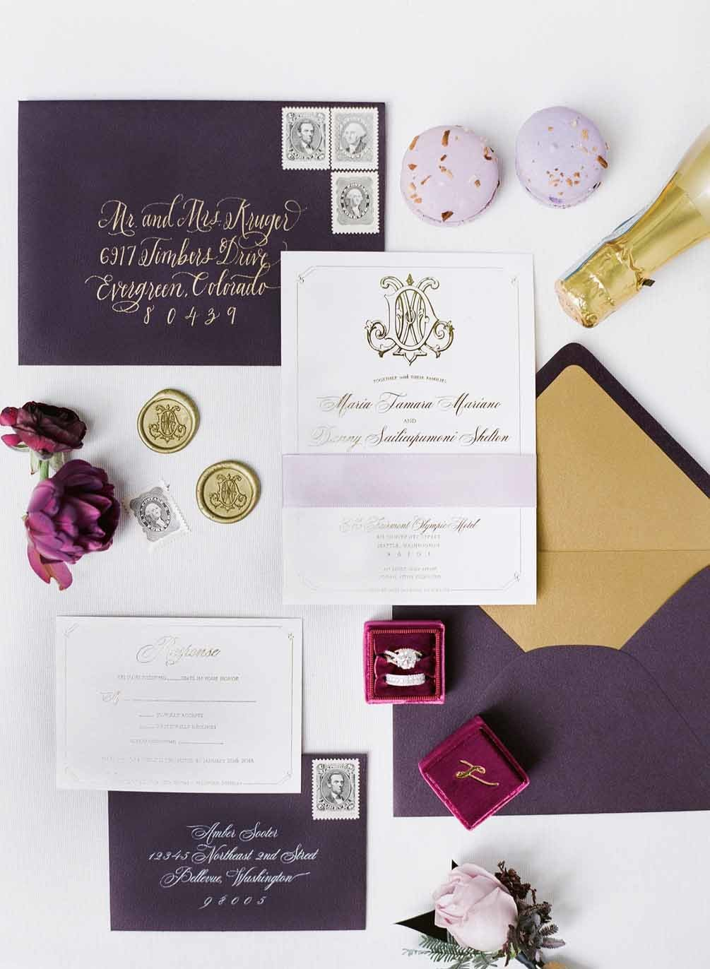 Elegant plum wedding invitation suite styled flat lay
