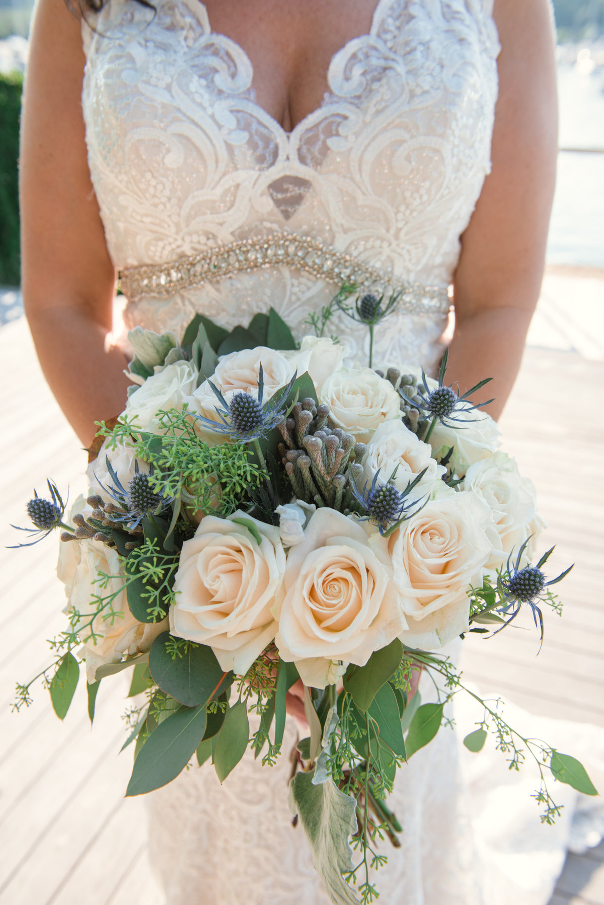 bride-holding-floral-bouquet-at-prime