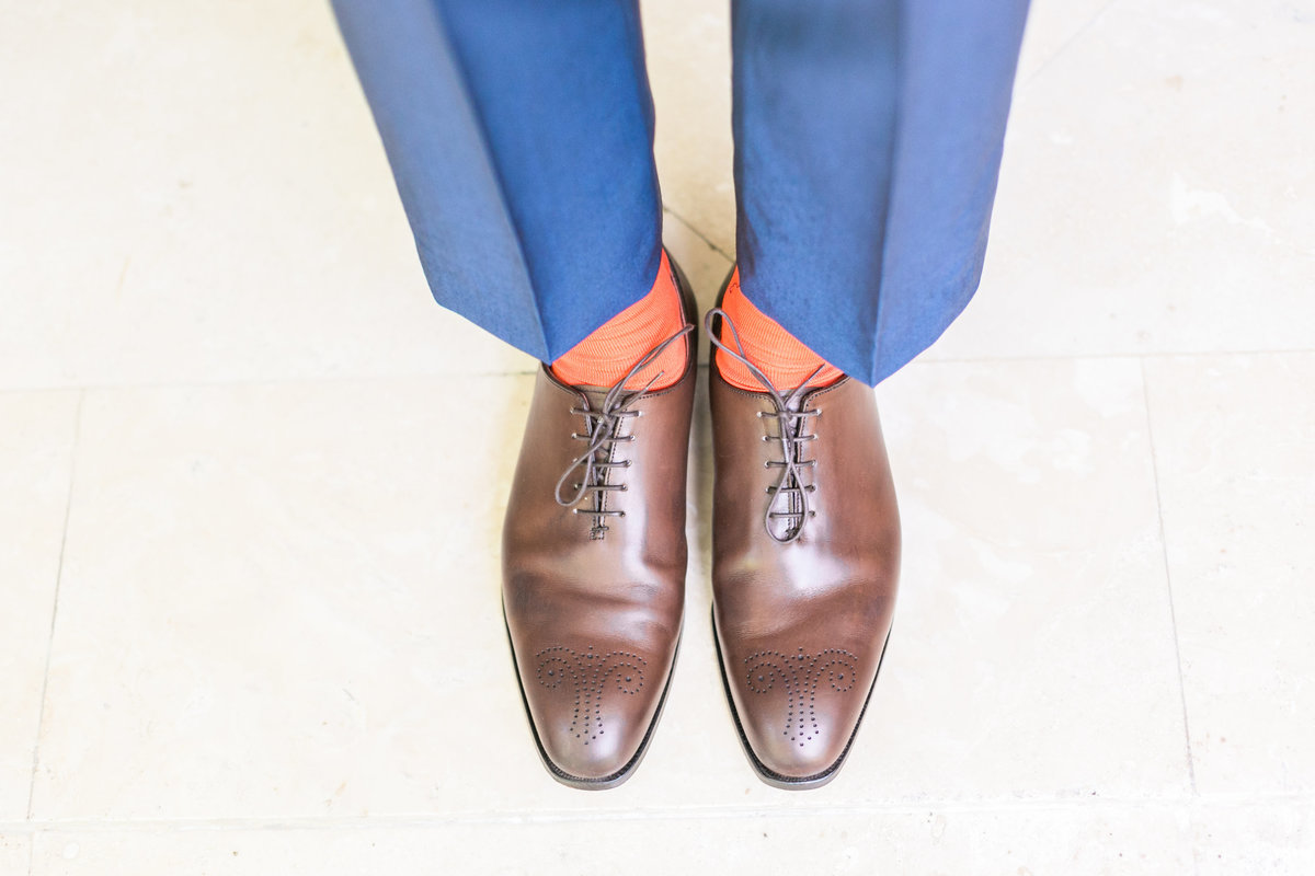 Handmade brown wholecut dress shoes with toe medallion design, made from fine calf leather, worn by groom on wedding day, made by Crockett & Jones - fine English leather shoes - with orange socks