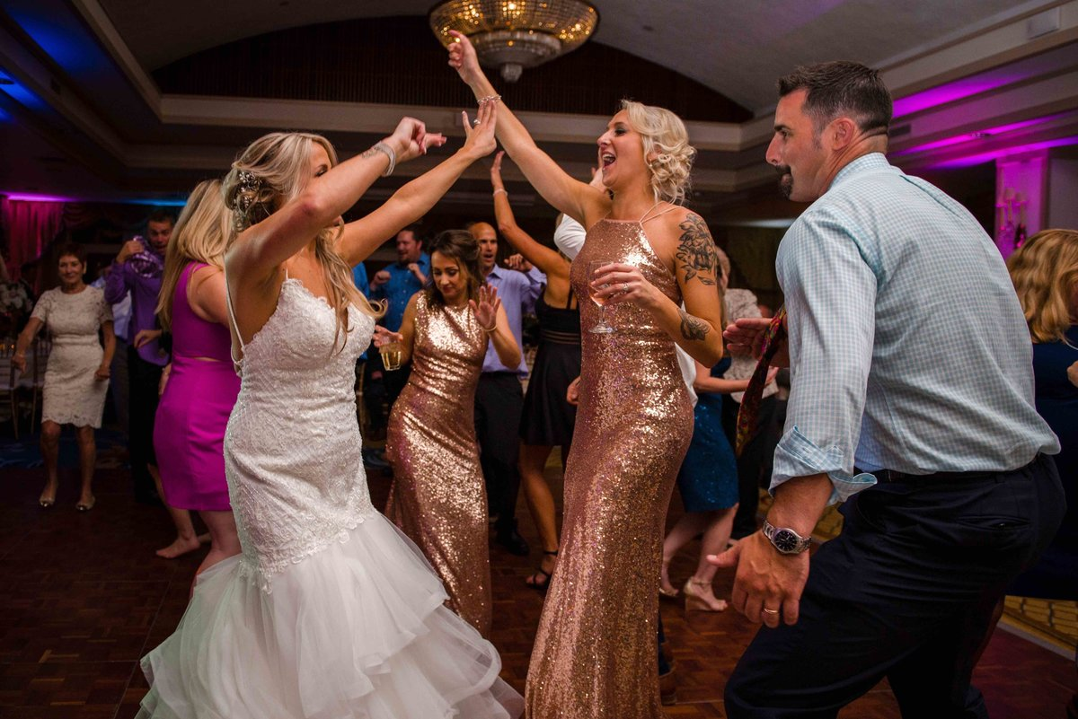 14 Waters Edge Resort and Spa weddings bride dancing with bridesmaids