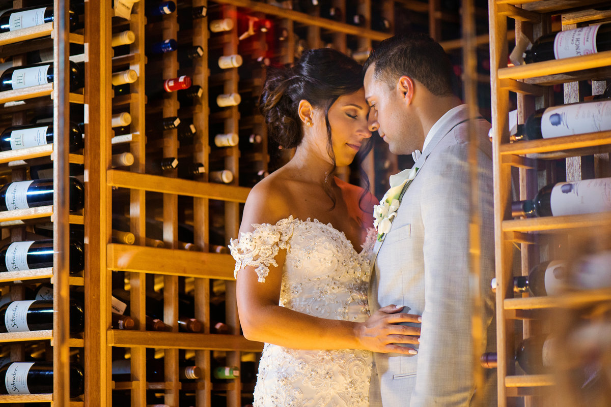 Bride and Groom inside the wine cellar