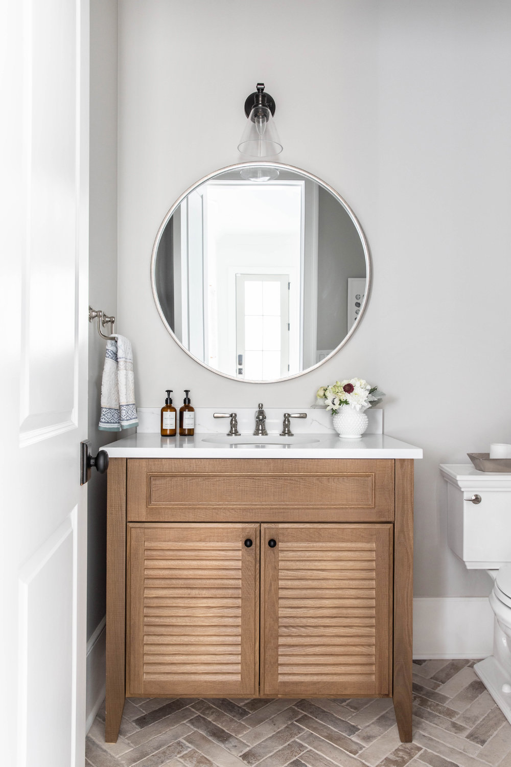 White-Oak-Louvered-Vanity-with-brick-herringbone-floor-2