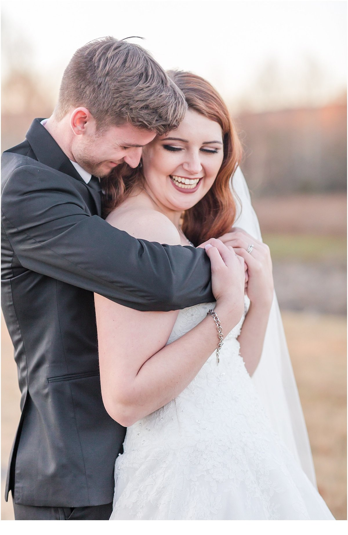 Bride and Groom enjoying romantic embrace during their Heritage Acres Farm Wedding Clarksville AR