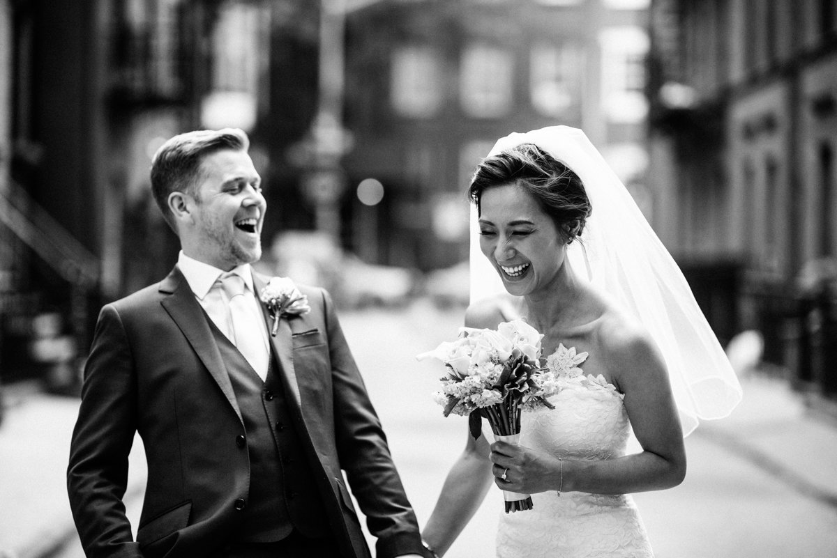 Just married couple laughing in the west village of NYC