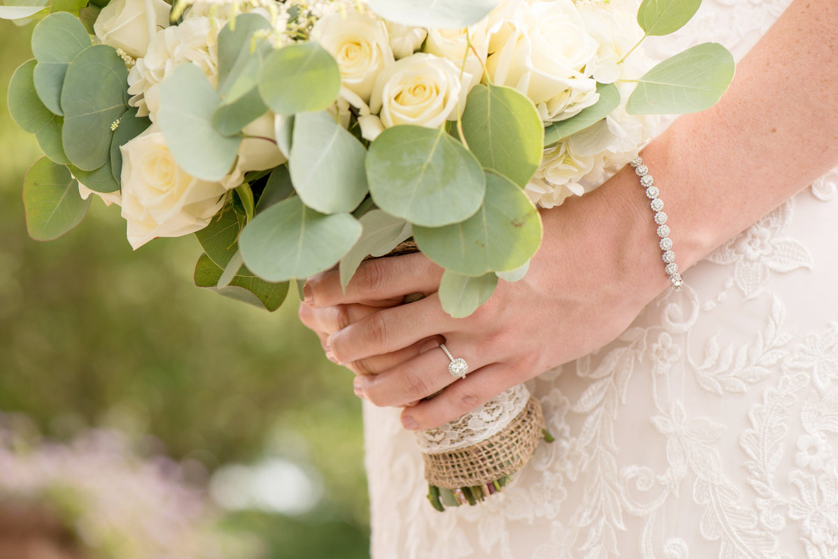 close up of bride holding her bouquet at Willow Creek Golf and Country Club wedding
