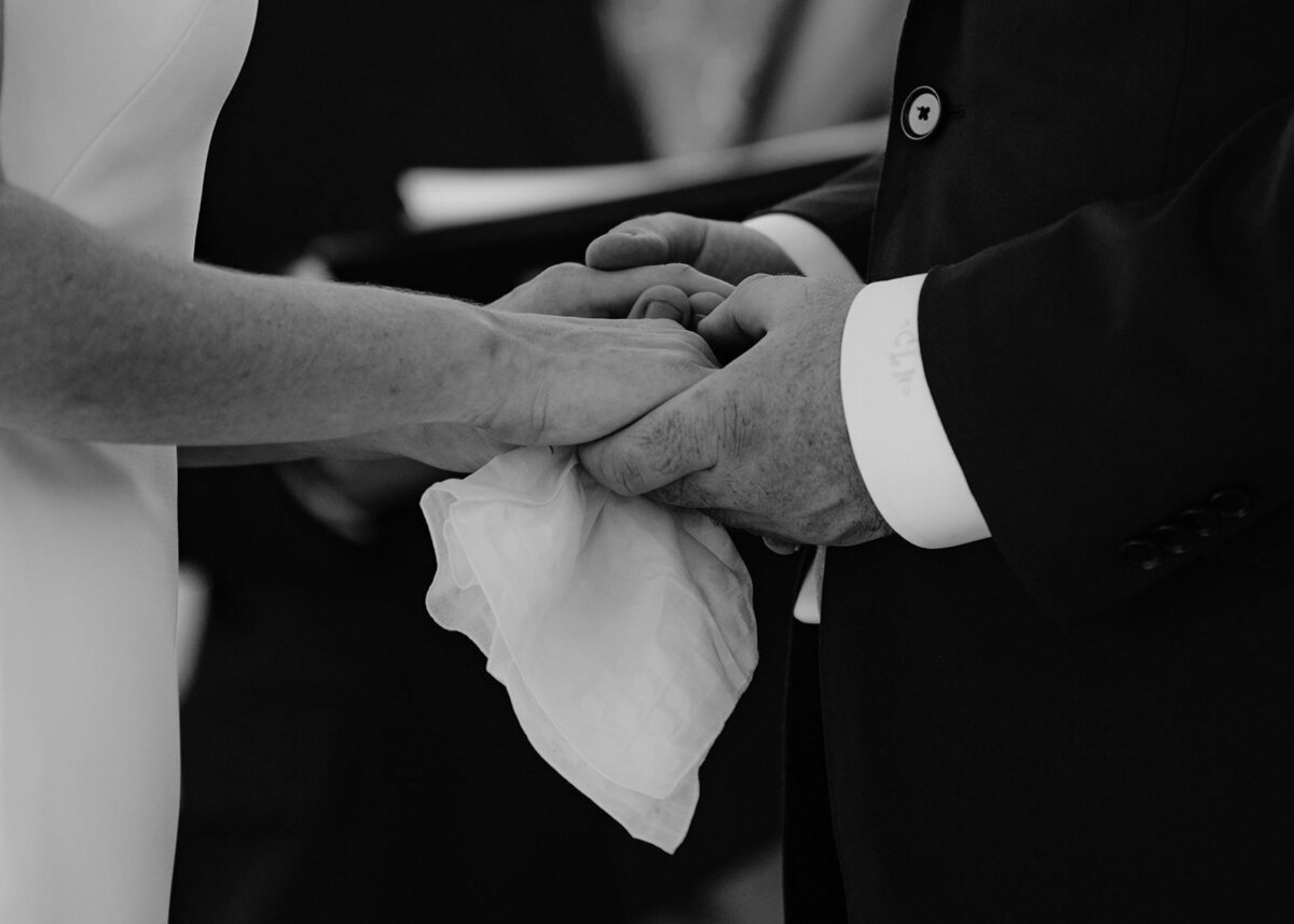 castine maine wedding ceremony couple holding hands