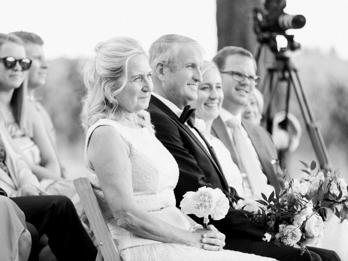 parents of the bride watching the wedding ceremony