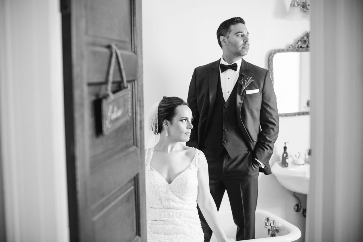 bride and groom in bathtub at water witch club wedding