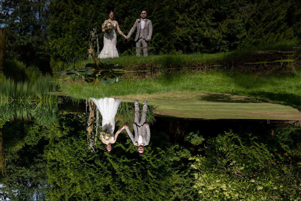 Bride and Groom reflected in pond at Bovey Castle